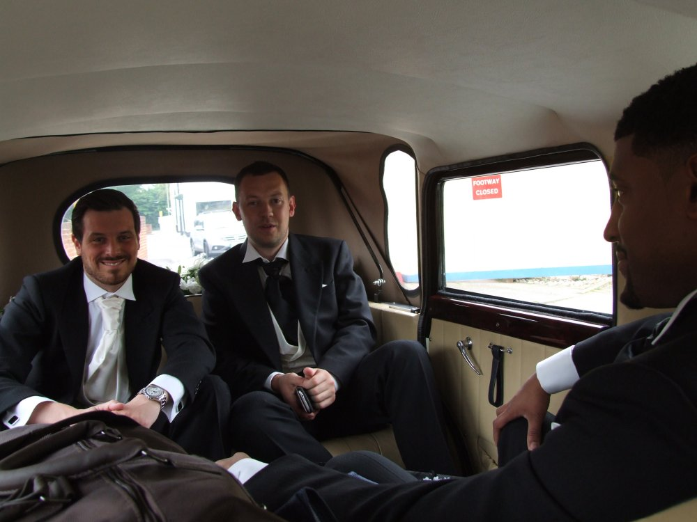 Groom enjoying the ride to his wedding