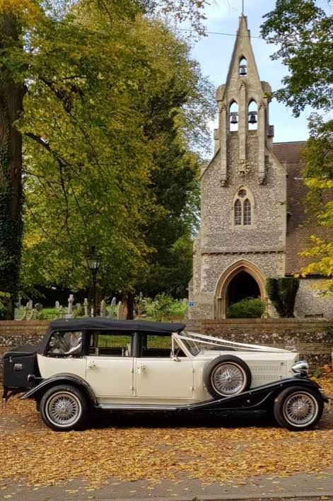 Beauford wedding car in autumn leaves